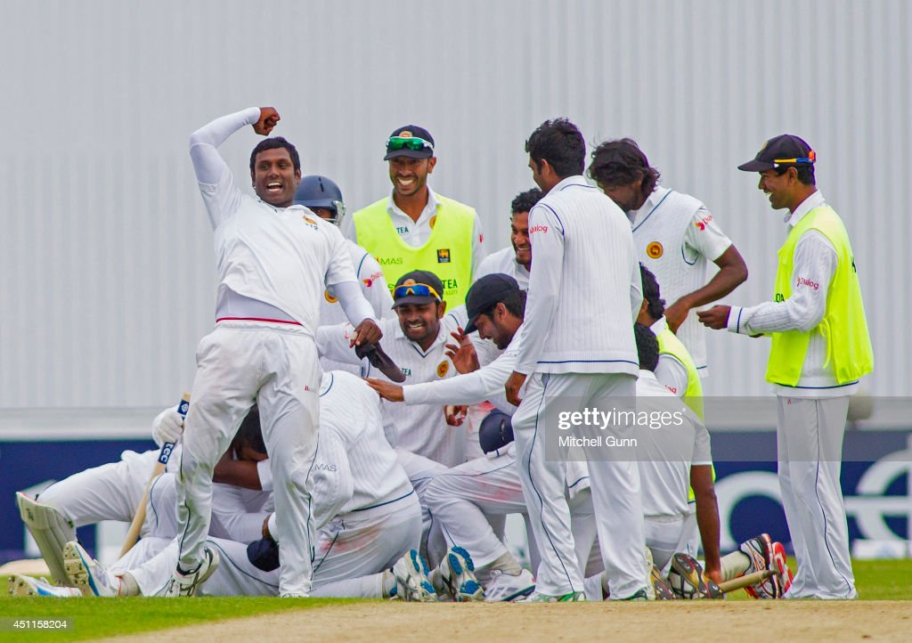 Angelo Mathews punches the air as his team celebrate winning the 2nd Investec Test Match day five between England and Sri Lanka at Headingley Cricket Ground, on June 24, 2014 in Leeds, England.