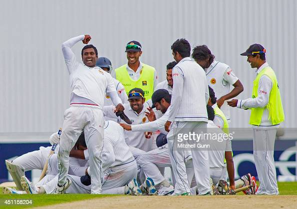 Angelo Mathews punches the air as his team celebrate winning the 2nd Investec Test Match day five between England and Sri Lanka at Headingley Cricket...