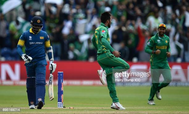 Angelo Matthews of Sri Lanka walks off after being dismissed as Mohammed Amir of Pakistan celebrates during the ICC Champions Trophy match between...