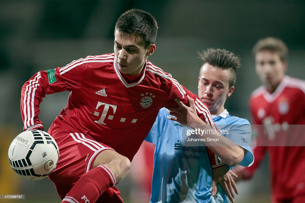 Angelo Mayer (C) of 1860 Muenchen battles for the ball with Milos Pantovic of FC Bayern during the A Juniors Bundesliga match between 1860 Muenchen and Bayern Muenchen at Stadion an der Gruenwalder Strasse on February 21, 2014 in Munich, Germany.