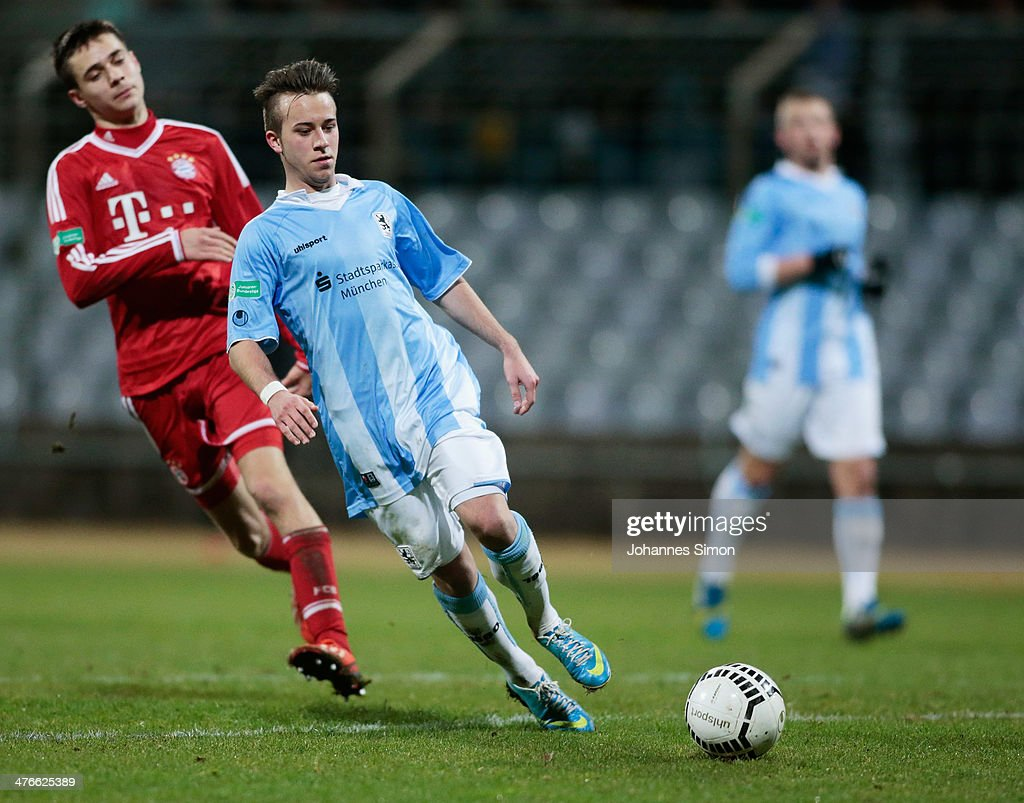 Angelo Mayer (C) of 1860 Muenchen battles for the ball with Milos Pantovic (L) of FC Bayern during the A Juniors Bundesliga match between 1860 Muenchen and Bayern Muenchen at Stadion an der Gruenwalder Strasse on February 21, 2014 in Munich, Germany.