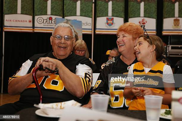 HAMILTON ON AUGUST 26 Angelo Mosca shares a laugh with his wife Helen and a granddaughter at a Fundraiser in honour of Angelo Mosca TiCat great who...