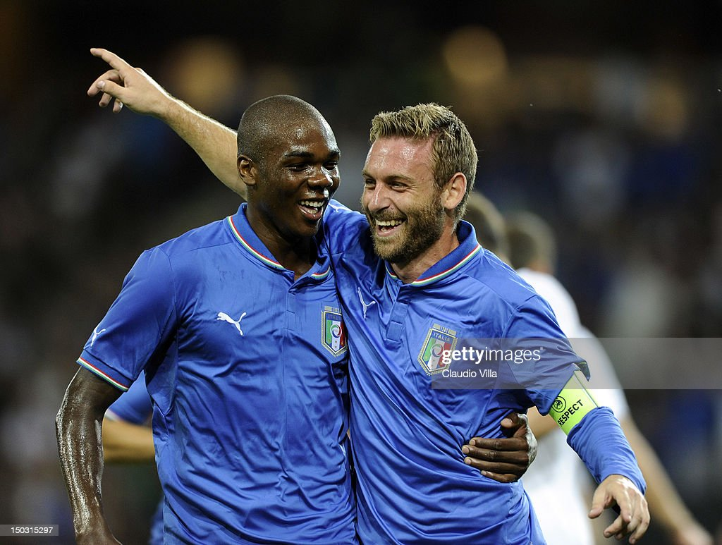 Angelo Ogbonna (L) and <a gi-track='captionPersonalityLinkClicked' href=/galleries/search?phrase=Daniele+De+Rossi&family=editorial&specificpeople=233652 ng-click='$event.stopPropagation()'>Daniele De Rossi</a> of Italy celebrates after scoring the first goal during the international friendly match between England and Italy at Stade de Suisse, Wankdorf on August 15, 2012 in Bern, Switzerland.