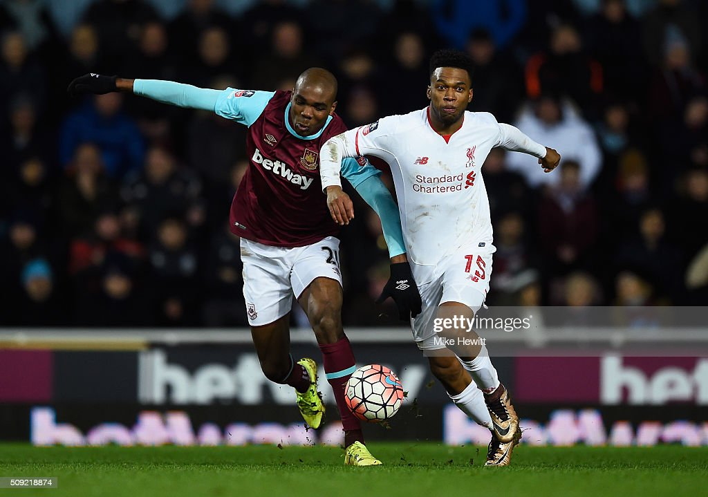 Angelo Ogbonna Obinza of West Ham United and <a gi-track='captionPersonalityLinkClicked' href=/galleries/search?phrase=Daniel+Sturridge&family=editorial&specificpeople=677270 ng-click='$event.stopPropagation()'>Daniel Sturridge</a> of Liverpool battle for the ball during the Emirates FA Cup Fourth Round Replay match between West Ham United and Liverpool at Boleyn Ground on February 9, 2016 in London, England.