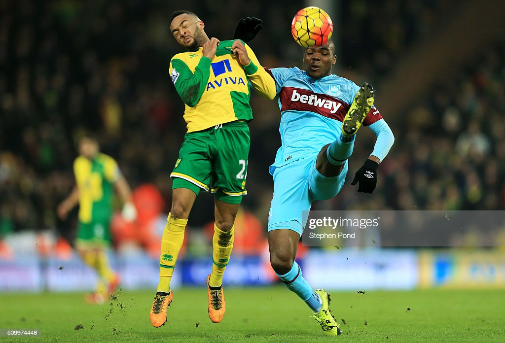Angelo Ogbonna Obinza of West Ham United and Hathan Redmond of Norwich City compete for the ball during the Barclays Premier League match between Norwich City and West Ham United at Carrow Road on February 13, 2016 in Norwich, England.