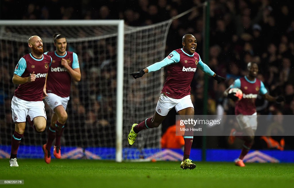Angelo Ogbonna Obinza of West Ham United (2R) celebrates as he scores their second goal during the Emirates FA Cup Fourth Round Replay match between West Ham United and Liverpool at Boleyn Ground on February 9, 2016 in London, England.