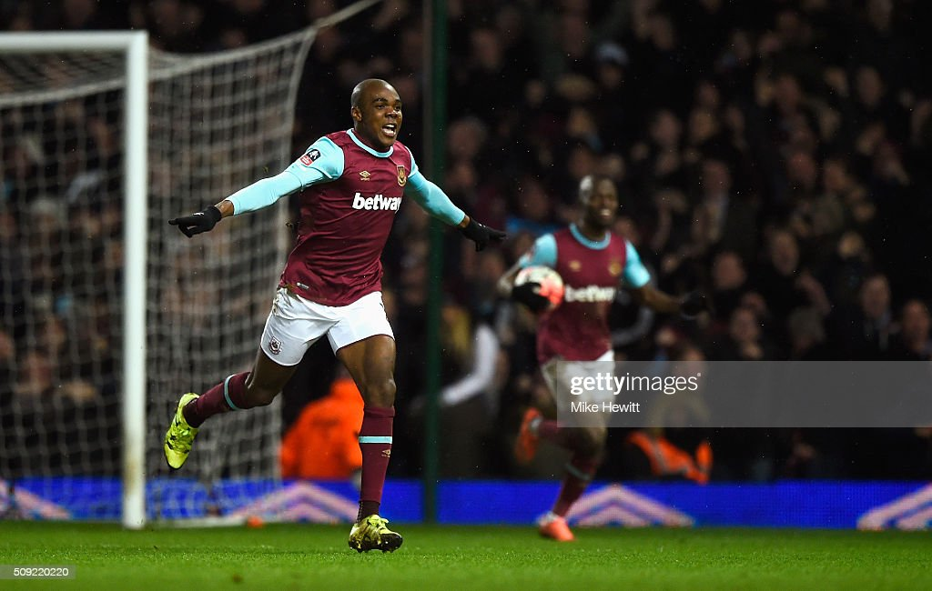 Angelo Ogbonna Obinza of West Ham United (L) celebrates as he scores their second goal during the Emirates FA Cup Fourth Round Replay match between West Ham United and Liverpool at Boleyn Ground on February 9, 2016 in London, England.