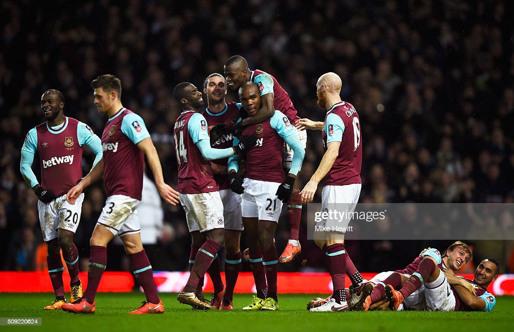 Angelo Ogbonna Obinza of West Ham United (21) celebrates with team mates as he scores their second goal during the Emirates FA Cup Fourth Round Replay match between West Ham United and Liverpool at Boleyn Ground on February 9, 2016 in London, England.
