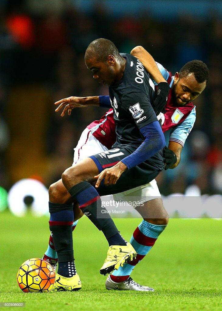 Angelo Ogbonna Obinza of West Ham United holds off Jordan Ayew of Aston Villa during the Barclays Premier League match between Aston Villa and West...