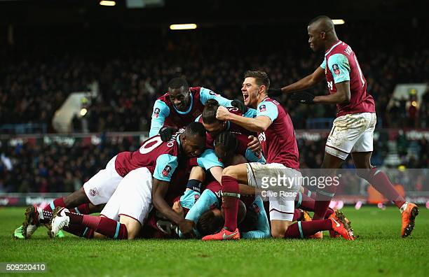 Angelo Ogbonna Obinza of West Ham United is mobbed in celebration by team mates as he scores their second goal during the Emirates FA Cup Fourth...