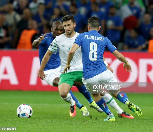 Angelo Ogbonna of Italy and Shane Long of Ireland and Alessandro Florenzi of Italy battle for the ball during the UEFA Euro 2016 Group E match...