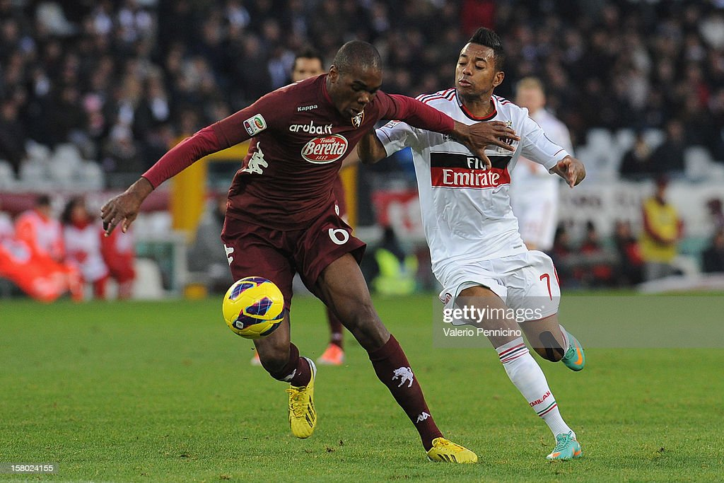 Angelo Ogbonna of Torino FC competes with <a gi-track='captionPersonalityLinkClicked' href=/galleries/search?phrase=Robinho&family=editorial&specificpeople=210767 ng-click='$event.stopPropagation()'>Robinho</a> of AC Milan during the Serie A match between Torino FC and AC Milan at Stadio Olimpico di Torino on December 9, 2012 in Turin, Italy.