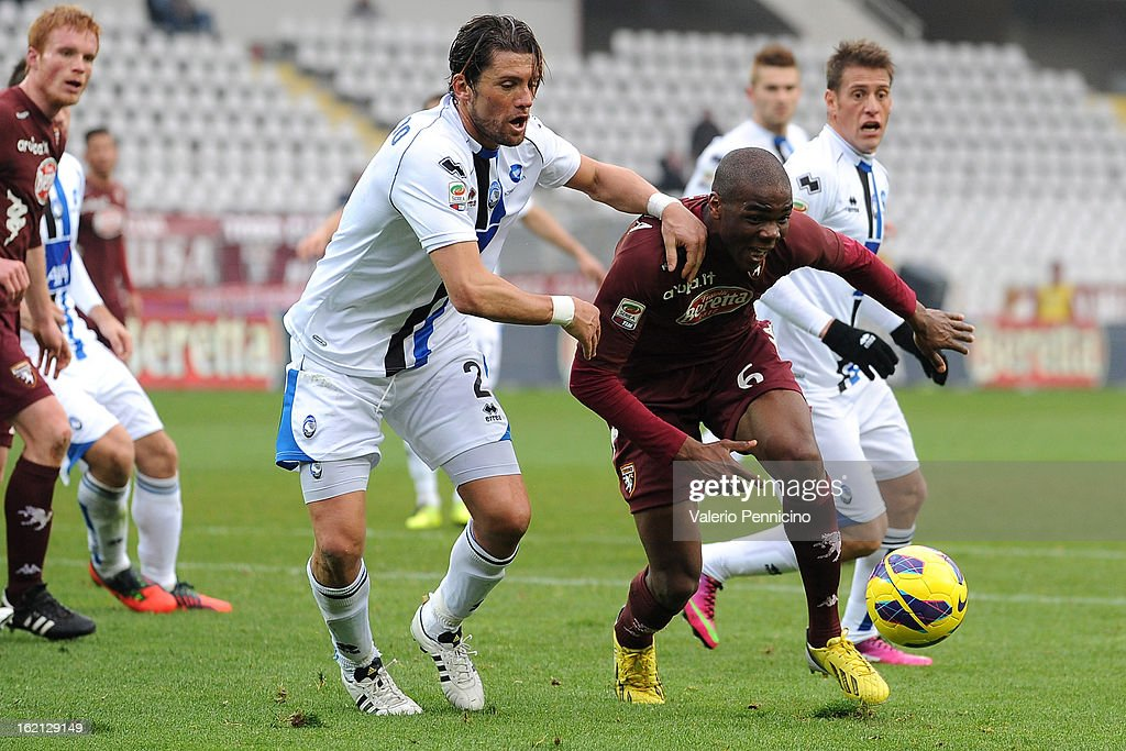 Angelo Ogbonna (R) of Torino FC is challenged by Guglielmo Stendardo of Atalanta BC during the Serie A match between Torino FC and Atalanta BC at Stadio Olimpico di Torino on February 17, 2013 in Turin, Italy.