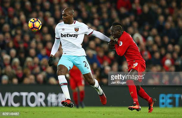 Angelo Ogbonna of West Ham United and Sadio Mane of Liverpool compete for the ball during the Premier League match between Liverpool and West Ham...