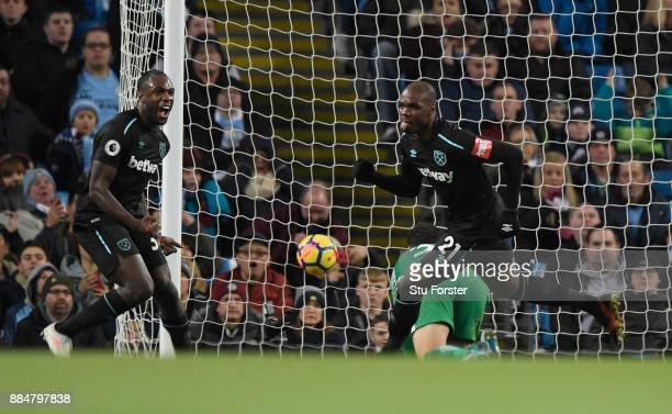 Angelo Ogbonna of West Ham United celebrates scoring his sides first goal with team mate Michail Antonio of West Ham United during the Premier League...