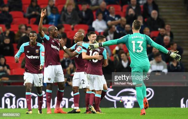 Angelo Ogbonna of West Ham United celebrates with team mates after scoring his side's third goal during the Carabao Cup Fourth Round match between...