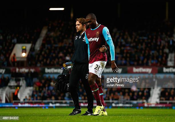 Angelo Ogbonna of West Ham United leaves the field injured during the Barclays Premier League match between West Ham United and Newcastle United at...