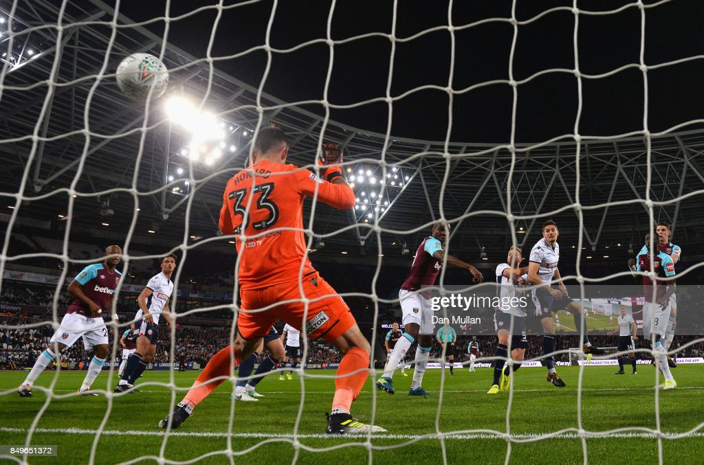 Angelo Ogbonna of West Ham United scores his sides first goal past Mark Howard of Bolton Wanderers during the Carabao Cup Third Round match between West Ham United and Bolton Wanderers at The London Stadium on September 19, 2017 in London, England.