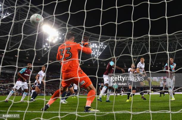 Angelo Ogbonna of West Ham United scores his sides first goal past Mark Howard of Bolton Wanderers during the Carabao Cup Third Round match between...