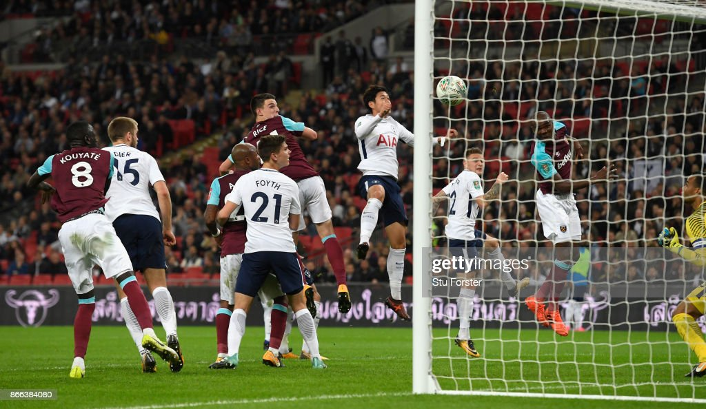 Angelo Ogbonna of West Ham United (r) scores his side's third goal during the Carabao Cup Fourth Round match between Tottenham Hotspur and West Ham United at Wembley Stadium on October 25, 2017 in London, England.