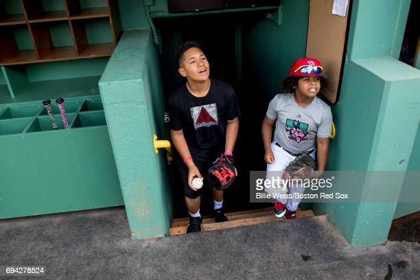 Angelo Ortiz son of David Ortiz of the Boston Red Sox and Hansel Ramirez son of Hanley Ramirez walk into the dugout before a game against the Detroit...
