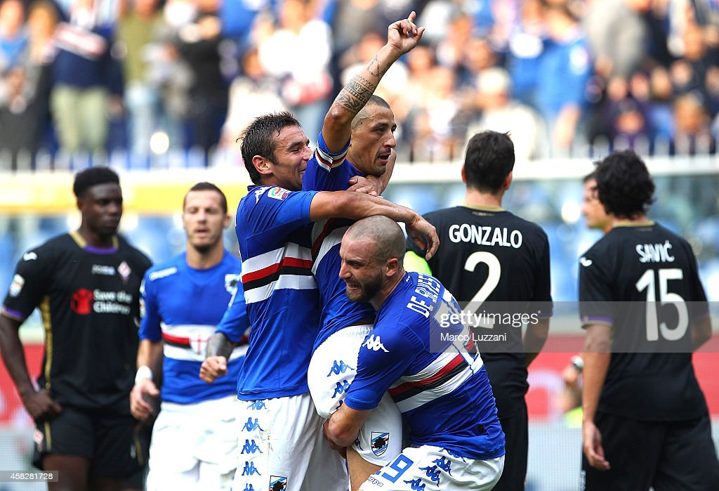 Angelo Palombo of UC Sampdoria celebrates with his teammates Gonzalo Ruben Bergessio and Lorenzo De Silvestri after scoring the opening goal from the...