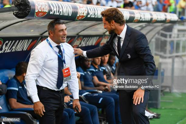 Angelo Peruzzi and Claudio Marchisio during the Italian Supercup match between Juventus and SS Lazio at Stadio Olimpico on August 13 2017 in Rome...
