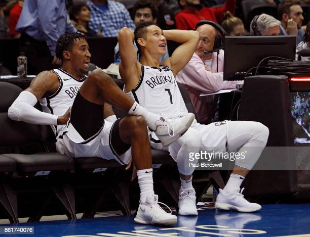 Angelo Russell and Jeremy Lin of the Brooklyn Nets sit waiting for the officials to fix the clock to start a preseason NBA basketball game against...