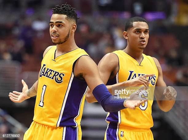 Angelo Russell and Jordan Clarkson of the Los Angeles Lakers react to a Sacramento Kings foul during a preseason game at Honda Center on October 4...