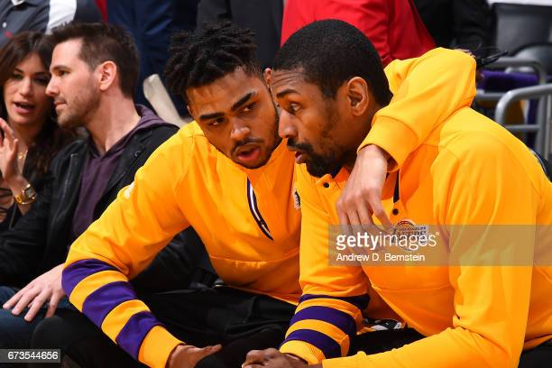 Angelo Russell and Metta World Peace of the Los Angeles Lakers talk before a game against the Milwaukee Bucks on March 17 2017 at STAPLES Center in...