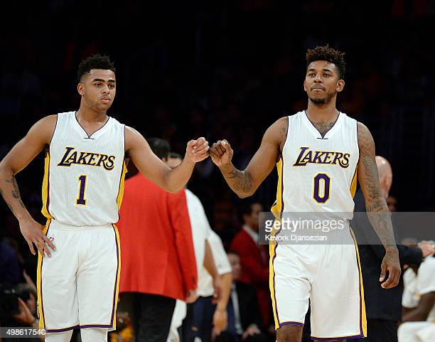 Angelo Russell and Nick Young of the Los Angeles Lakers pump fists during the second half of the basketball game against Portland Trail Blazers at...