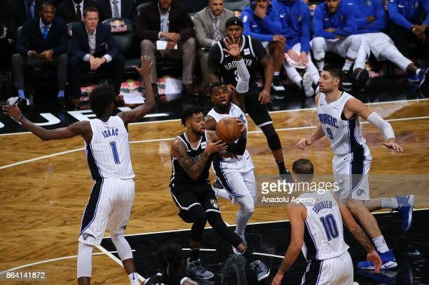 Angelo Russell of Brooklyn Nets in action against Nikola Vucevic of Orlando Magic during NBA basketball match between Brooklyn Nets and Orlando Magic...