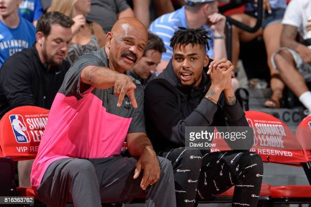D' Angelo Russell of the Brooklyn Nets and John Lucas of the Houston Rockets watch from the sidelines in a game against the Atlanta Hawks during the...