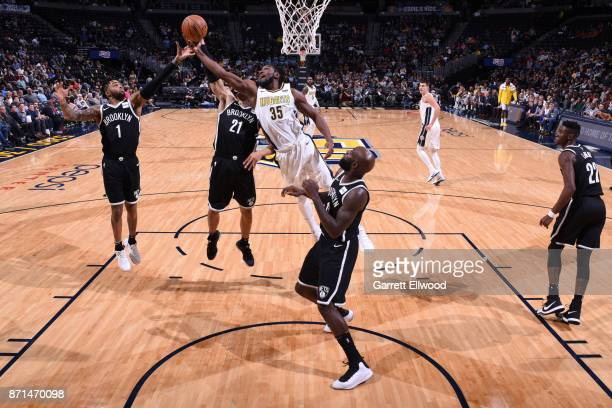 Angelo Russell of the Brooklyn Nets and Kenneth Faried of the Denver Nuggets vie for the ball during the game on November 7 2017 at the Pepsi Center...