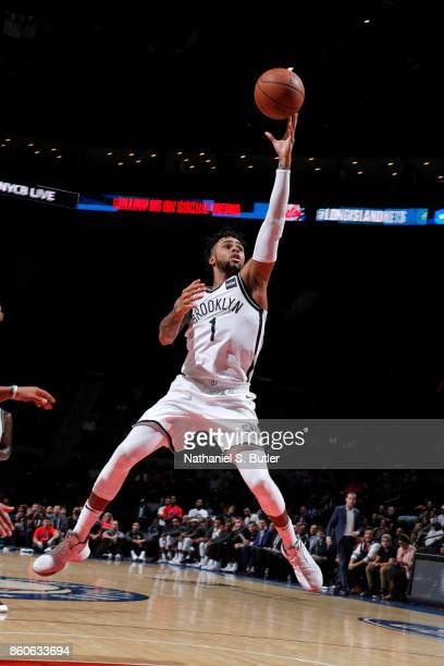 Angelo Russell of the Brooklyn Nets drives to the basket against the Philadelphia 76ers on October 11 2017 at Nassau Veterans Memorial Coliseum in...