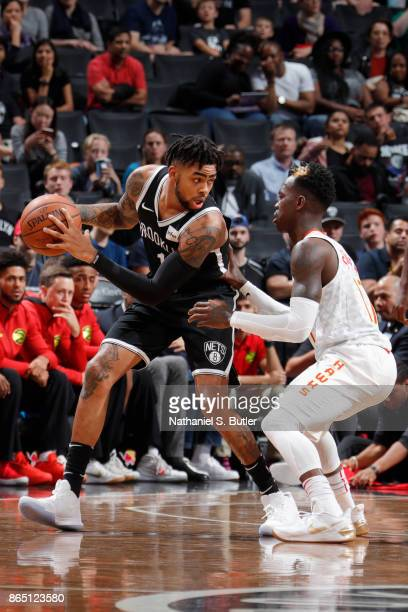 Angelo Russell of the Brooklyn Nets handles the ball against Dennis Schroder of the Atlanta Hawks during the game between the two teams on October 22...
