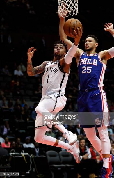 Angelo Russell of the Brooklyn Nets lays up a shot in front of Ben Simmons of the Philadelphia 76ers during a preseason NBA basketball game on...