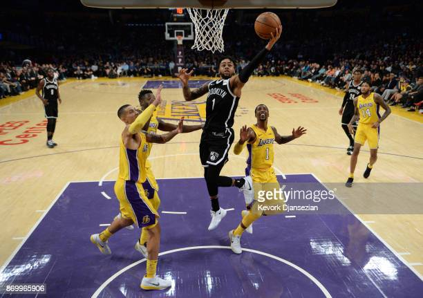 Angelo Russell of the Brooklyn Nets making his first come back to Staples Center score a basket against Kyle Kuzma Julius Randle and Kentavious...