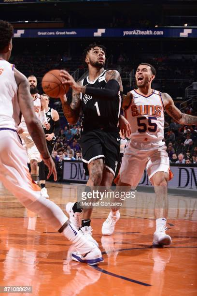 Angelo Russell of the Brooklyn Nets passes the ball against Mike James of the Phoenix Suns on November 6 2017 at Talking Stick Resort Arena in...