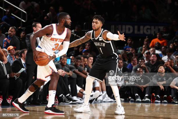 Angelo Russell of the Brooklyn Nets plays defense against Tim Hardaway Jr #3 of the New York Knicks during the preseason game on October 3 2017 at...