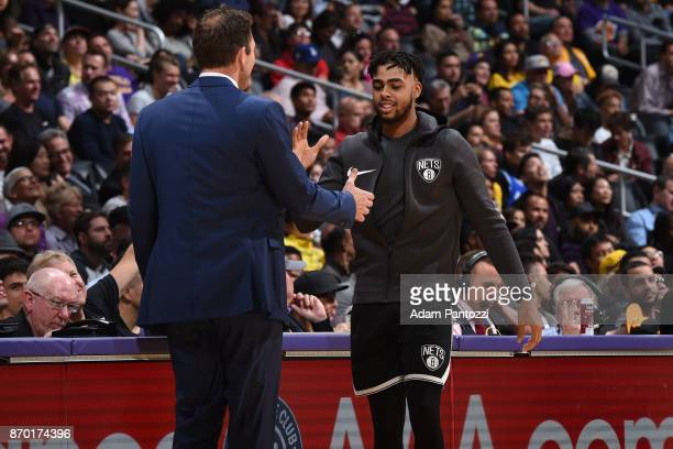 Angelo Russell of the Brooklyn Nets reacts with Head Coach Luke Walton of the Los Angeles Lakers on November 3 2017 at STAPLES Center in Los Angeles...