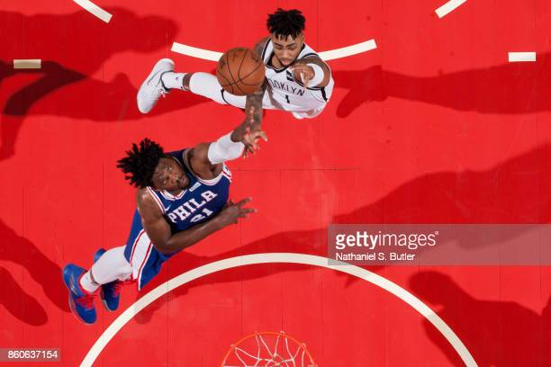 Angelo Russell of the Brooklyn Nets shoots the ball against Joel Embiid of the Philadelphia 76ers on October 11 2017 at Nassau Veterans Memorial...