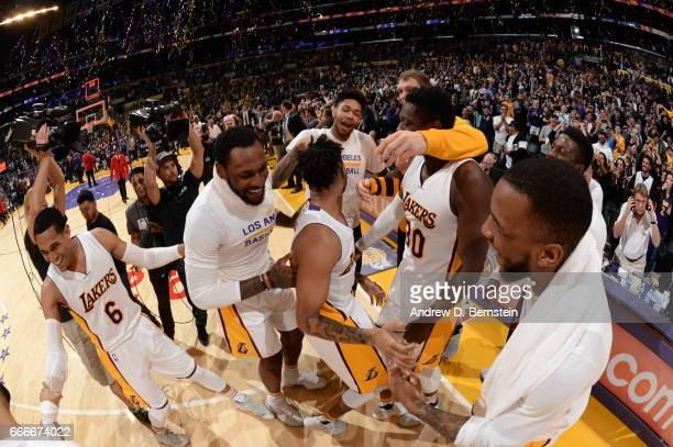 Angelo Russell of the Los Angeles Lakers celebrates with teamates after hitting the game winning shot against the Minnesota Timberwolves on April 9...
