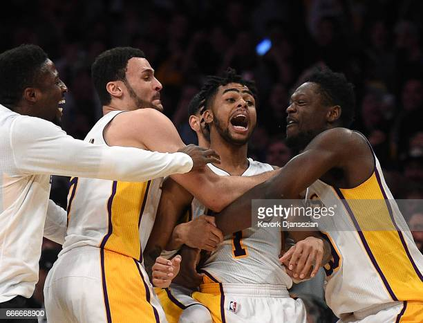 D'Angelo Russell of the Los Angeles Lakers is mobbed by teammates Julius Randle Larry Nance Jr #7 and David Nwaba after scoring a threepoint basket...