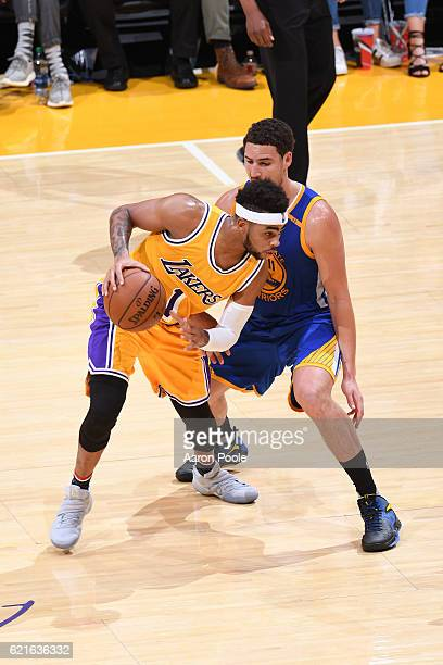 Angelo Russell of the Los Angeles Lakers looks to dribble the ball while guarded by Klay Thompson of the Golden State Warriors on November 4 2016 at...