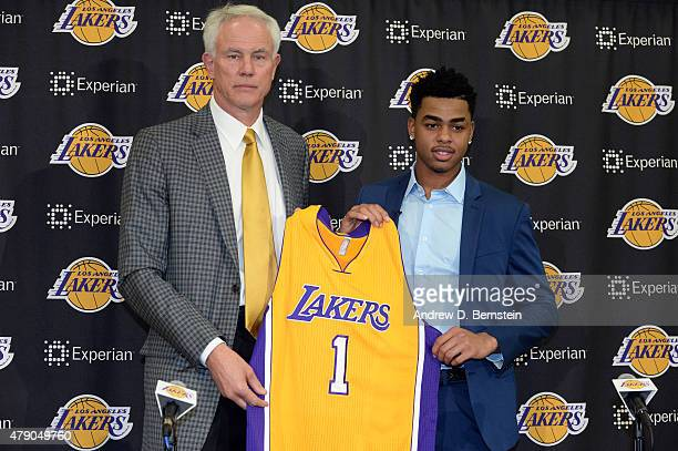 Angelo Russell of the Los Angeles Lakers poses for a photo with Lakers GM Mitch Kupchak at a press conference introducing draft picks at Toyota...