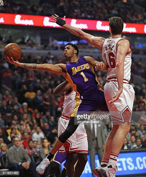 Angelo Russell of the Los Angeles Lakers puts up a sot around Pau Gasol of the Chicago Bulls at the United Center on February 21 2016 in Chicago...