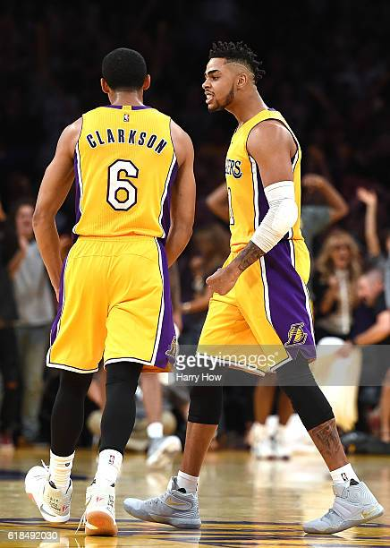 Angelo Russell of the Los Angeles Lakers reacts to a three pointer from Jordan Clarkson during a 120114 season opening win over the Houston Rockets...