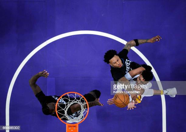 Angelo Russell of the Los Angeles Lakers scores a basket against Brandon Rush and Gorgui Dieng of the Minnesota Timberwolves during the first half of...