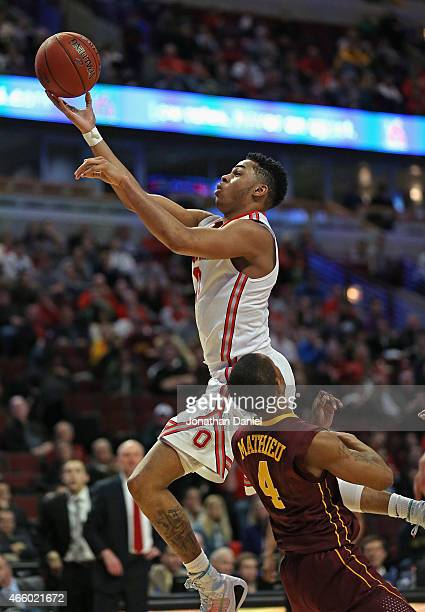 Angelo Russell of the Ohio State Buckeyes shoots over DeAndre Mathieu of the Minnesota Golden Gophers during the second round of the 2015 Big Ten...